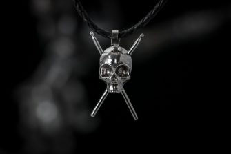 Martian Skull with Drum Sticks pendant front
